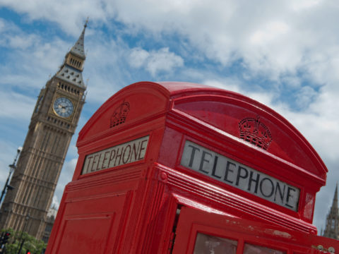 A traditional red telephone box sits beside Big Ben and The Houses of Parliament in Parliament Square in London on August 4, 2012, during London 2012 Olympic Games. AFP PHOTO / WILL OLIVER
